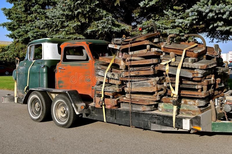 Load of old radiators. A trailer is loaded with the cab of two old pickups and stacks of rusty radiators for recycling stock photo