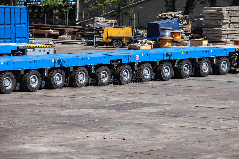 Trailer platform. Heavy load transportation trailer with many platform stock photos