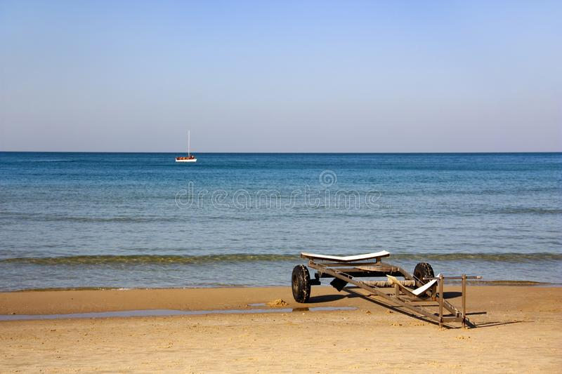 Trailer for transporting boats is on the beach royalty free stock photo