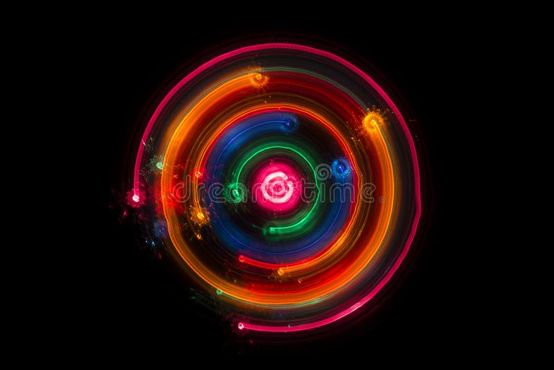Trails of multicolored radial lights blurred on black. Can use background royalty free stock photos