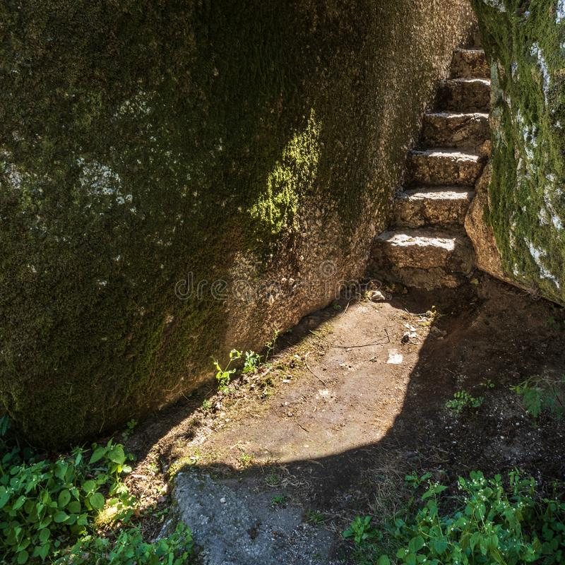 Trails and stairs through granite boulders on Penha Mountain, Portugal royalty free stock photos