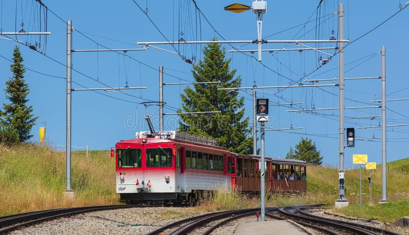 A train approaching the Rigi-Staffel station in Switzerland royalty free stock photography