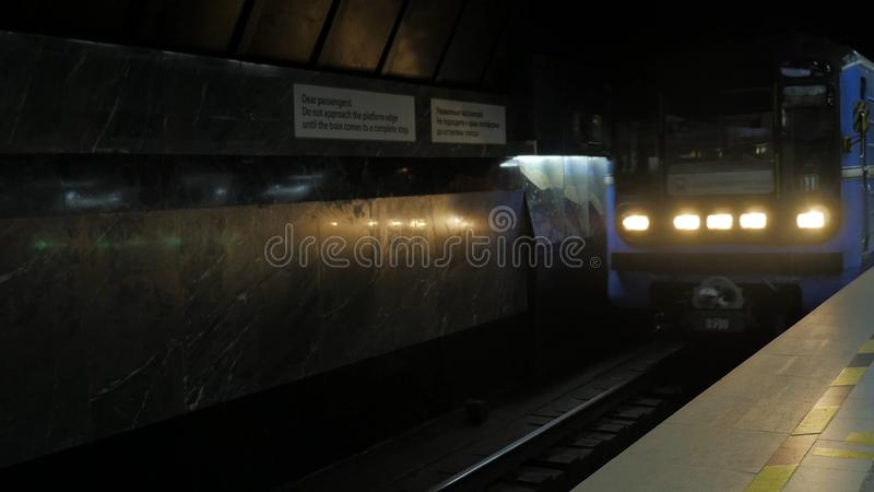 The train arrives at subway station. City underground metro station. Train leaving metro station stock image
