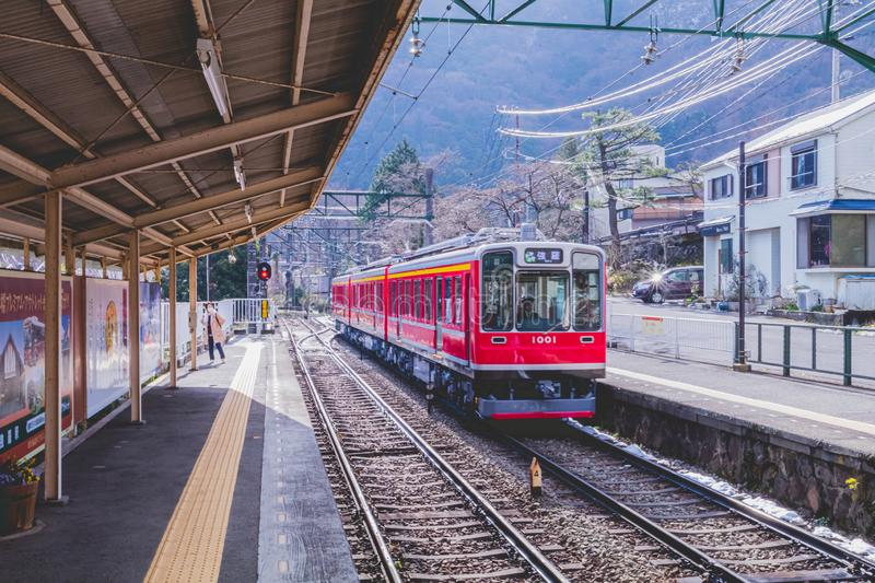 Train arriving at the Hakone Tozan Line platform royalty free stock images