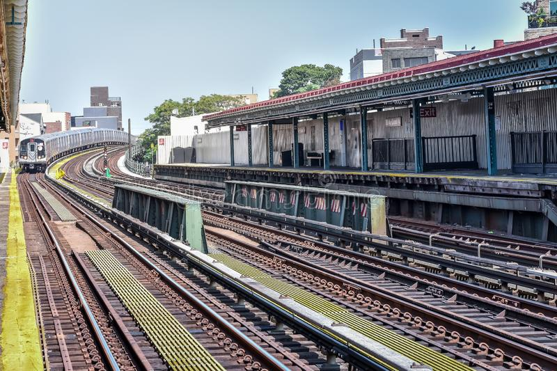 Train arriving at the station in New York City. Buildings in the background, cityscape. Travel and transit concept. Manhattan, NYC. USA stock images
