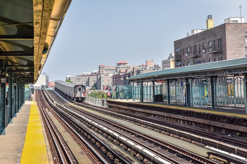 Train arriving at the station in New York City. Buildings in the background, cityscape. Travel and transit concept. Manhattan, NYC. USA stock photography
