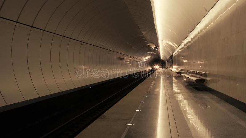 The train arriving to the subway station stock photography