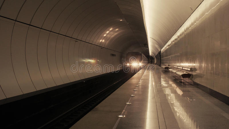 The train arriving to the subway station stock images