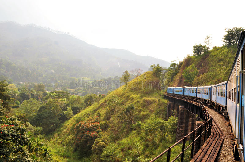 Train on bridge in hill country of Sri Lanka royalty free stock images