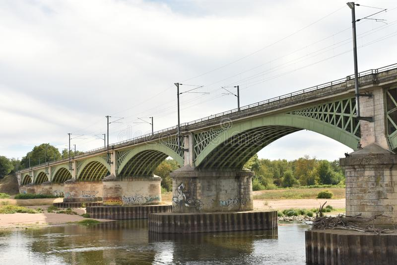 Train bridge in Nevers - NEVERS - France. Nevers first enters written history as Noviodunum, a town held by the Aedui at Roman contact. The quantities of medals stock photo