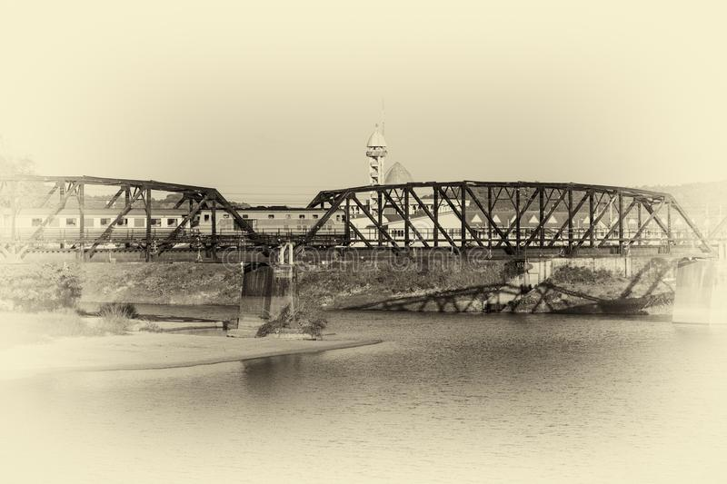 Train on a bridge over river. with image vintage tone.  royalty free stock images