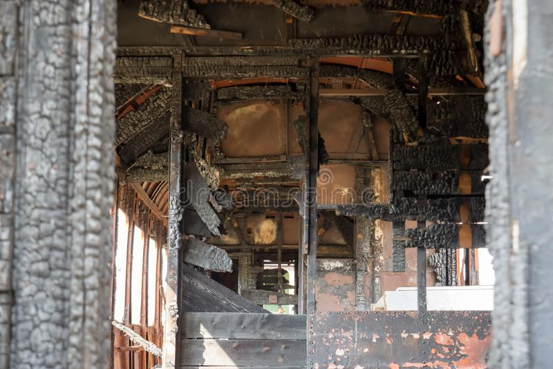 The train car burnt from the inside stock images