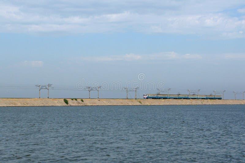 Train on causeway line at Kakhovka Water Reservoir, Ukraine stock photo