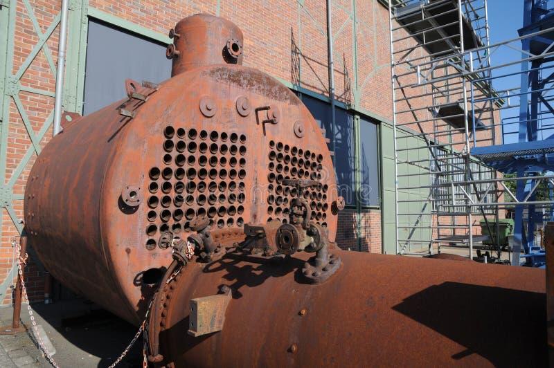 Train cemetery. Old rusty mining locomotive museum stock image