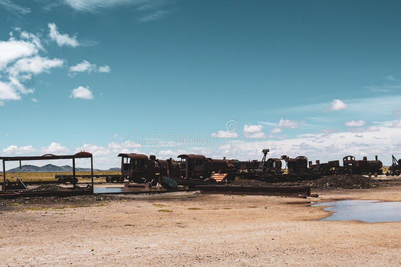 Train cemetery in Salar de Uyuni stock photo