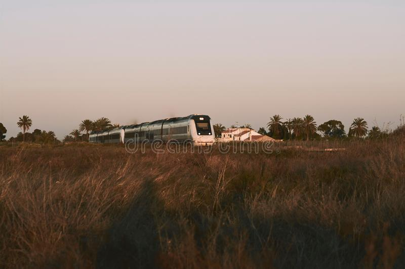 Train circulating during sunset in the province of Alicante in Spain.  royalty free stock image