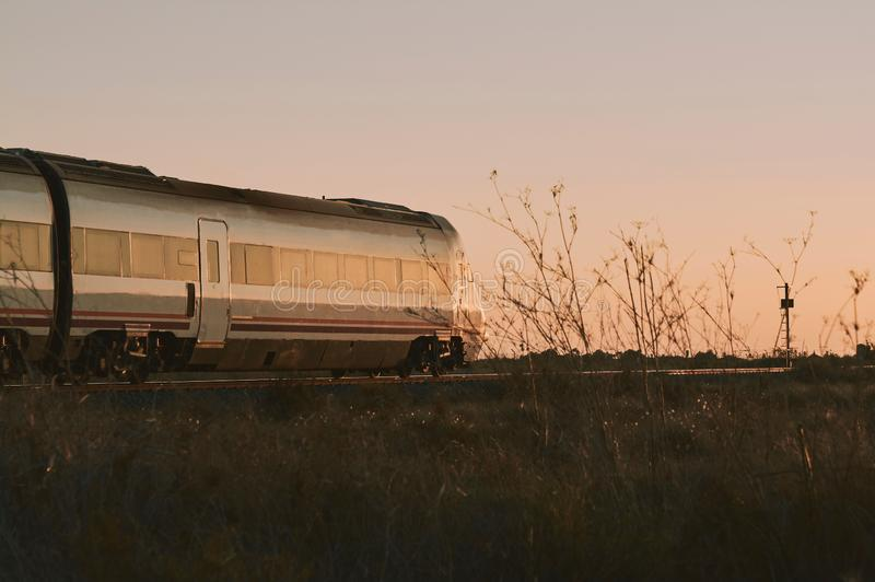 Train circulating during sunset in the province of Alicante in Spain.  royalty free stock photography