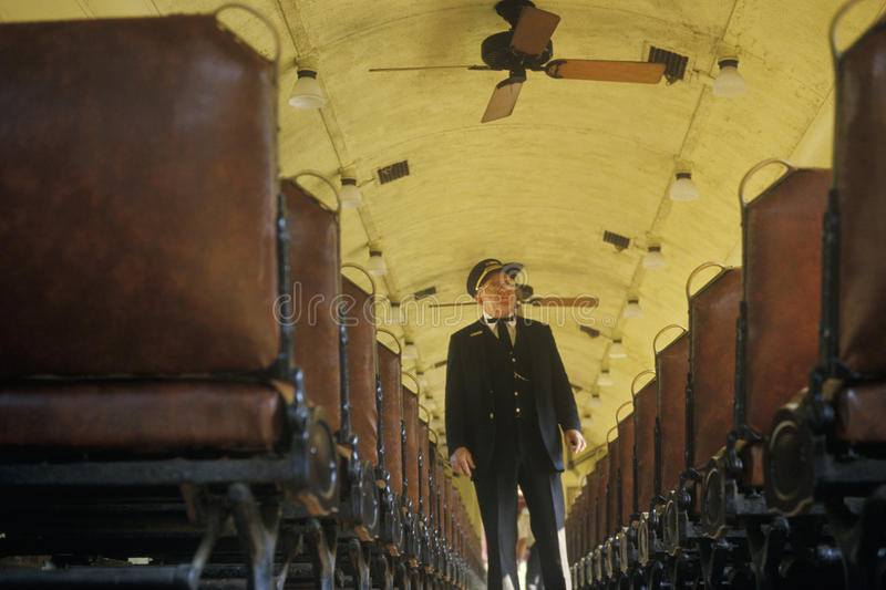 A train conductor aboard a standard gauge steam engine train in Eureka Springs, Arkansas stock image