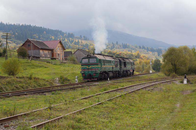Train in the countryside lit by the sun. Carpathians. Ukraine stock image