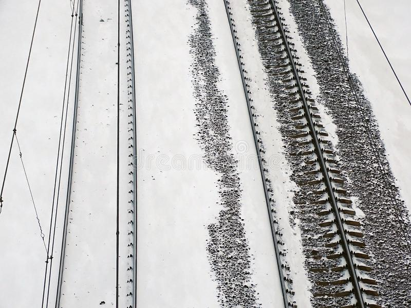 Train covered with snow on railway stock photo