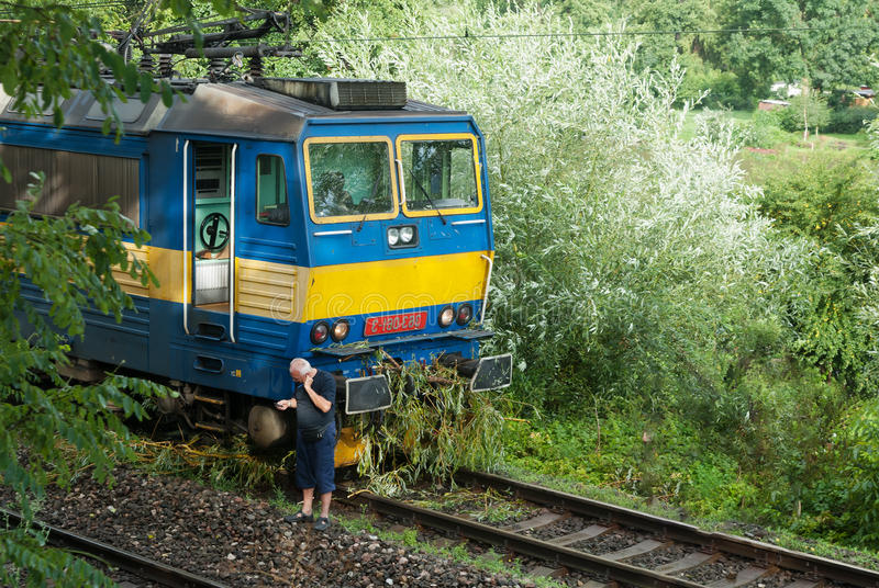 Train crash accident, tree fall on railway tracks, broken breches, driver reporting royalty free stock photography