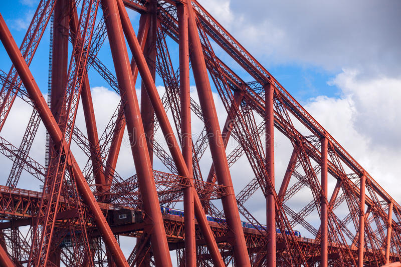 Train crosses the Forth Railway Bridge in Edinburgh, Scotland. Train crosses the Forth Railway Bridge over Firth of Forth in Edinburgh, Scotland. Closeup details royalty free stock images