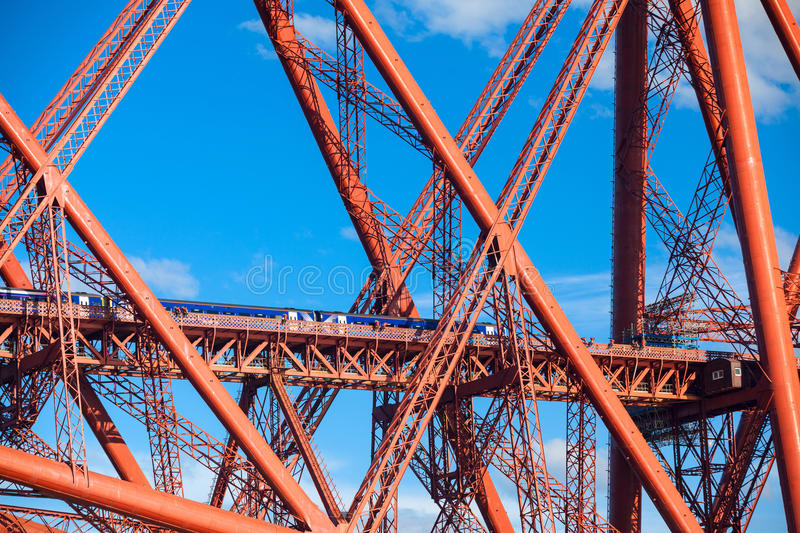 Train crosses the Forth Railway Bridge in Edinburgh, Scotland. Train crosses the Forth Railway Bridge over Firth of Forth in Edinburgh, Scotland. Closeup details stock photography