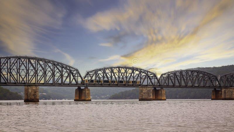 Train crossing Railway Bridge over the Hawkesbury River from Dangar Island, NSW, Australia royalty free stock photo