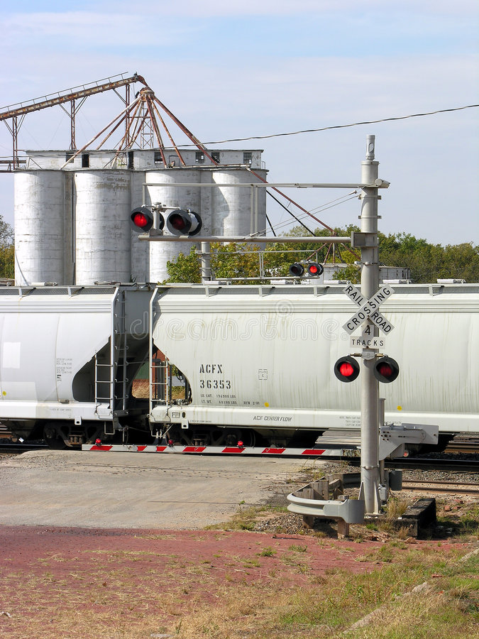 Train Crossing with Silos royalty free stock image