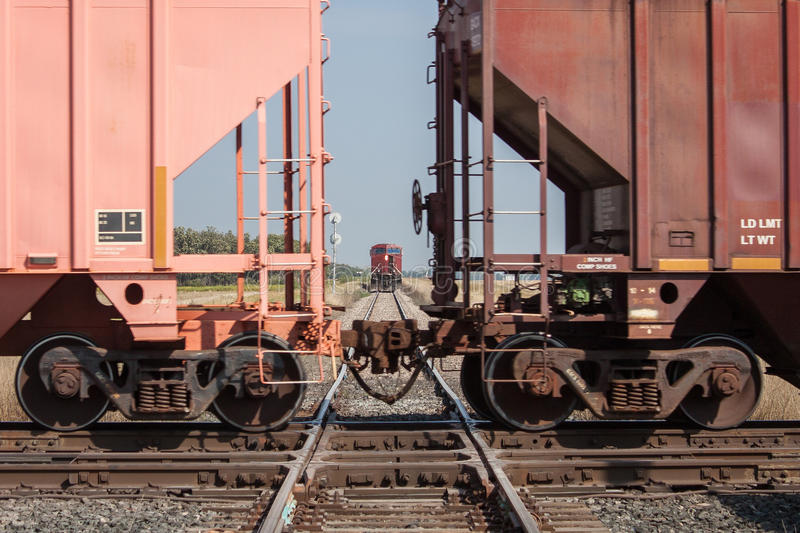 Train Crossing a Track With Another Train Waiting royalty free stock photos