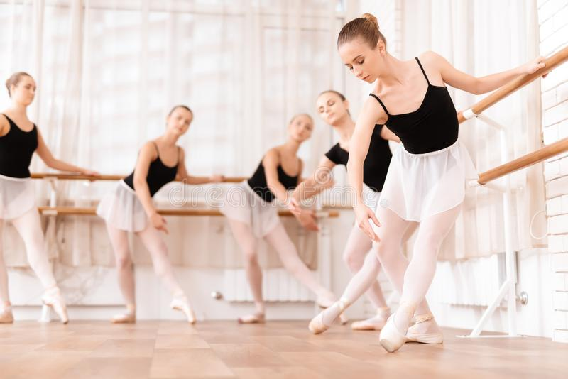 Girls ballet dancers rehearse in ballet class. They train dance moves. They use ballet barre. They are professional theater actors stock photos