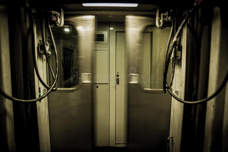 Train doors as they close. Inside of a train when the doors closing quickly frontally stock photos