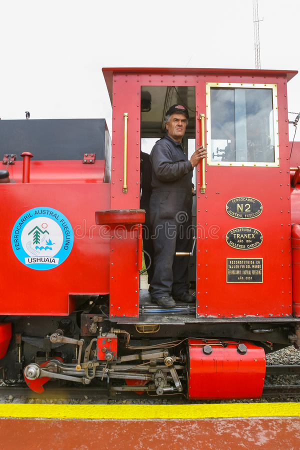 Train driver in Ushuaia. USHUAIA, ARGENTINA - FEBRUARY 2, 2006 : The driver of the Train of the End of the World standing in the cabin at the Southern Fuegian stock photo