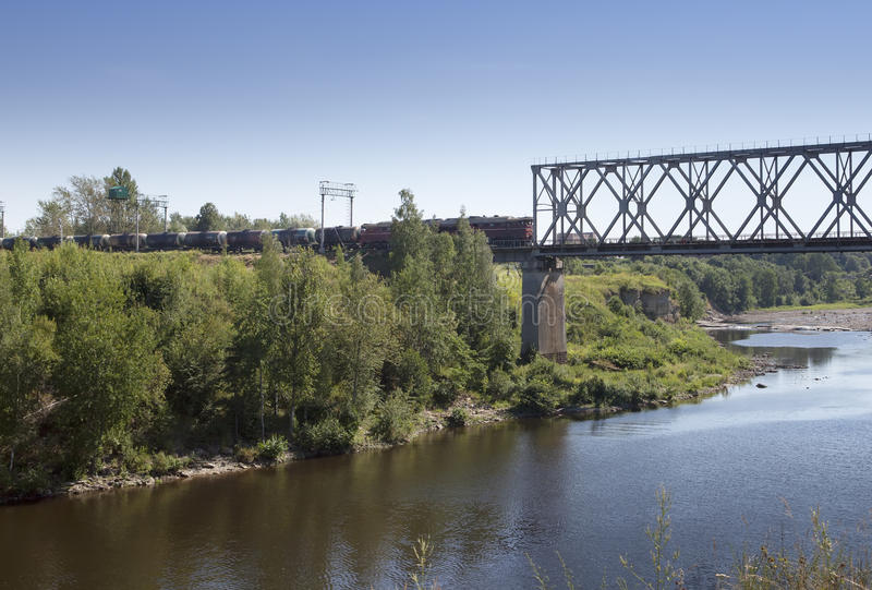 The train drives on the bridge through the river Narva. Estonia. The train drives on the bridge through river Narva. Estonia royalty free stock image