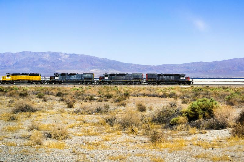 Train engines stopped on the tracks going through Searles Valley, Mojave Desert, California stock photo