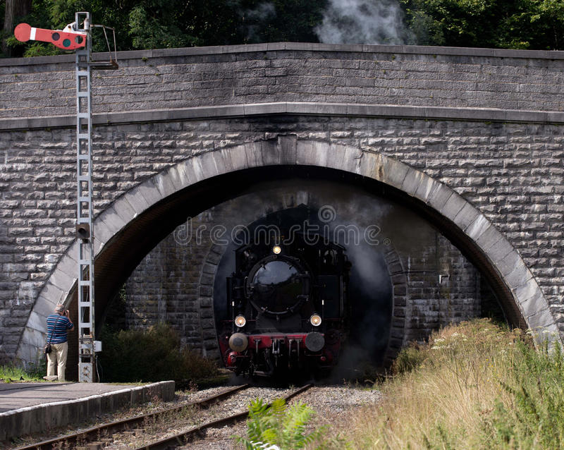 Train exiting the tunnel. Steam train exiting the tunnel stock photography