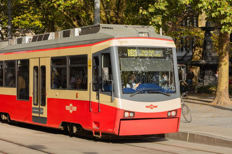 A train of the Forch railway in the city of Zurich, Switzerland. Zurich, Switzerland - September 29, 2017: a train of the Forch railway at the stop on royalty free stock images