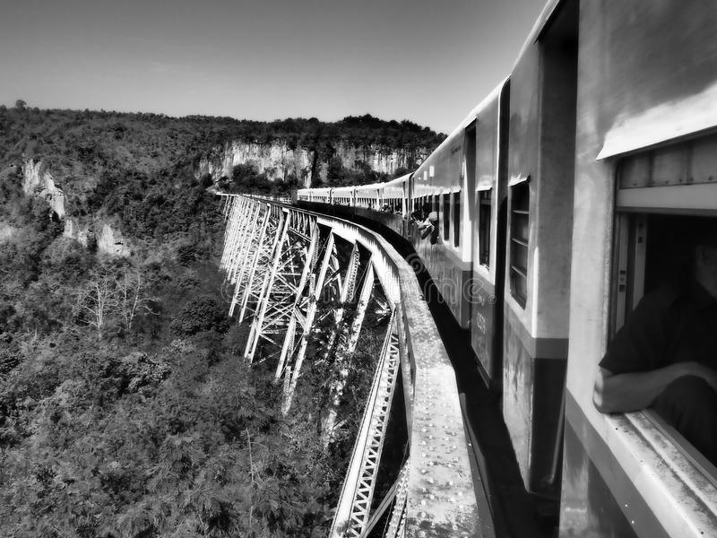 Train going over gorge in Myanmar, southeast asia. Train and aqueduct in Myanmar, travel and tourism stock photography
