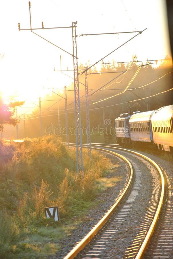 The train going towards the rising sun. Somewhere in Poland stock images