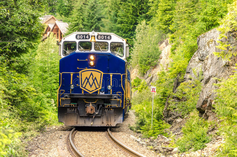 Train in a Gorge. Whistler, BC, Canada - June 28, 2014: Rocky Mountaineer Train getting into the Station. Rocky Mountaineer was founded in 1990, and it has royalty free stock photography