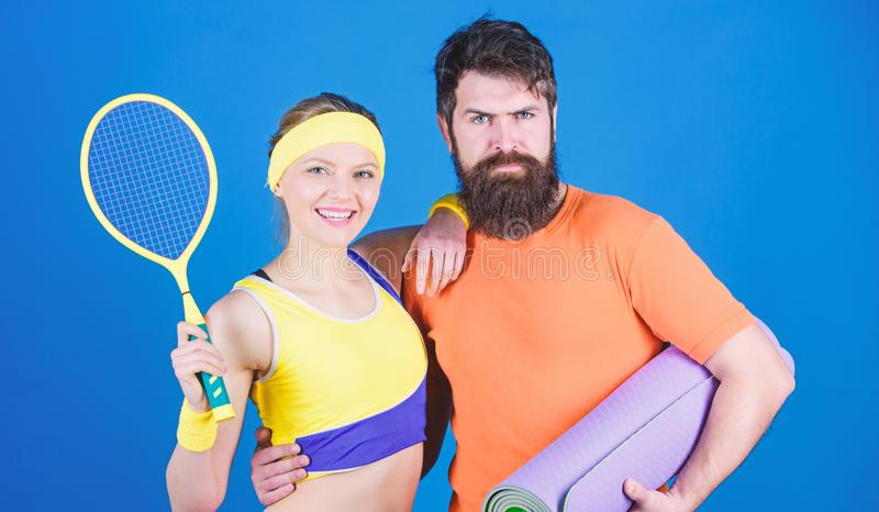 Train hard, win easy. Happy woman and bearded man workout in gym. Sporty couple training with fitness mat and tennis. Train hard, win easy. Happy women and stock photos