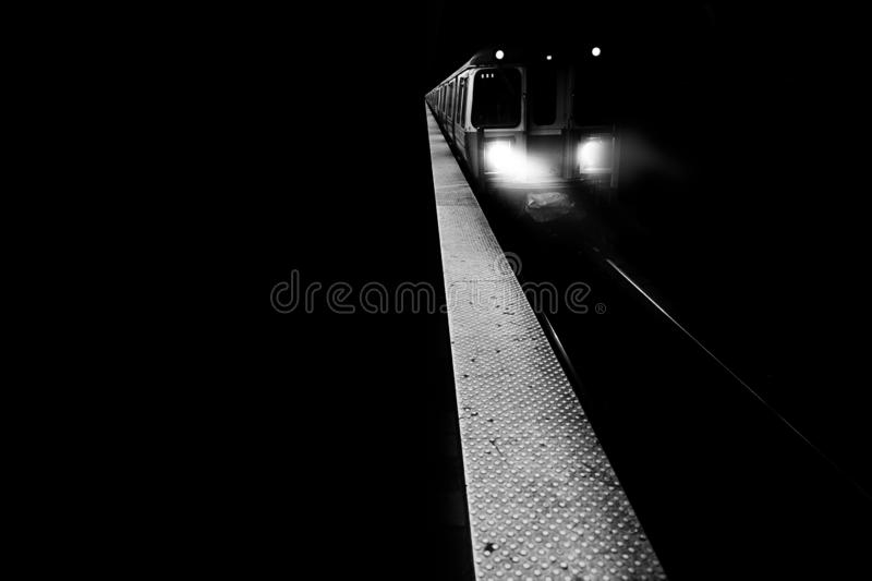 A train with lights on moving forward stock photography