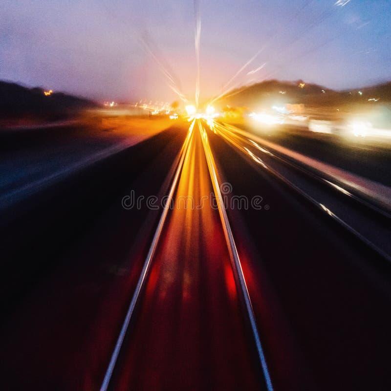 Train lights on track. Blur of train headlights speeding on track stock images