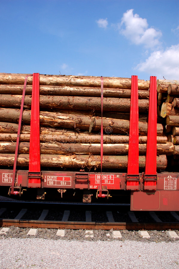 Train loaded with trees stock photos