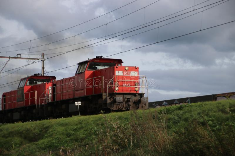 Train locomotive for freight train of DB is running at the railroad track in Nieuwerkerk aan den IJssel in the Netherlands stock photo