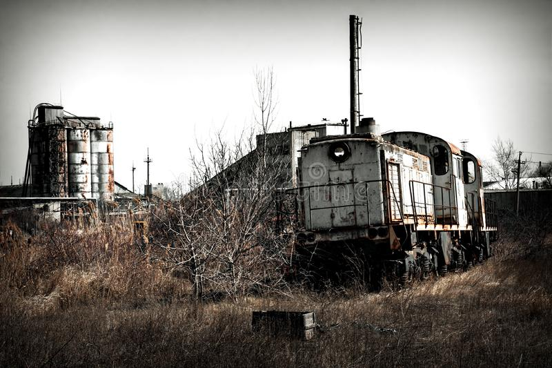 Train locomotive on the ruins. Of an unfinished nuclear power plant, Ukraine, Odessa region stock photos