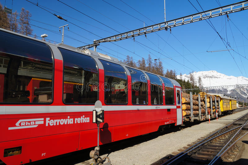 The train with logs at St.Moritz station , Switzerland stock photos