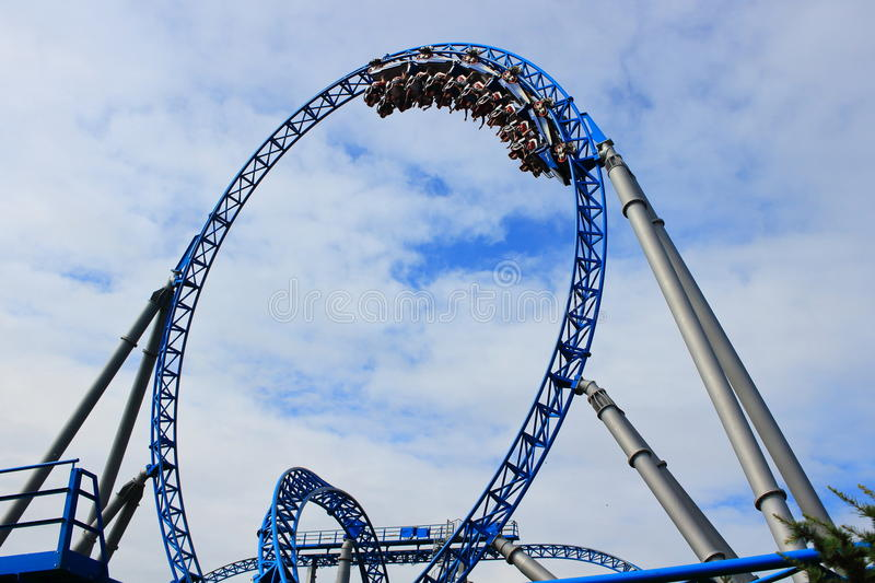 Train in loop of thrilling roller coaster royalty free stock images