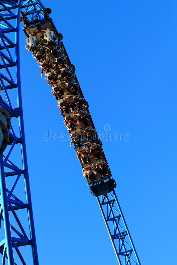 People looping in roller coaster stock photo