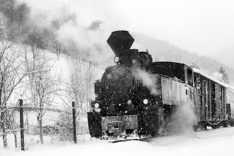 Train in Maramures forest, winter time royalty free stock photography